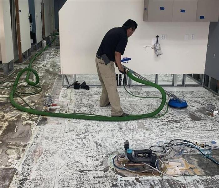 Photo of dental office being steam cleaned.